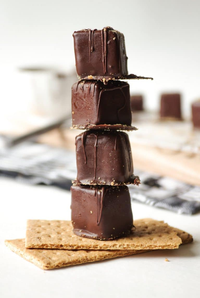 4 Chocolate Covered Cheesecake Bites stacked on 2 gram crackers