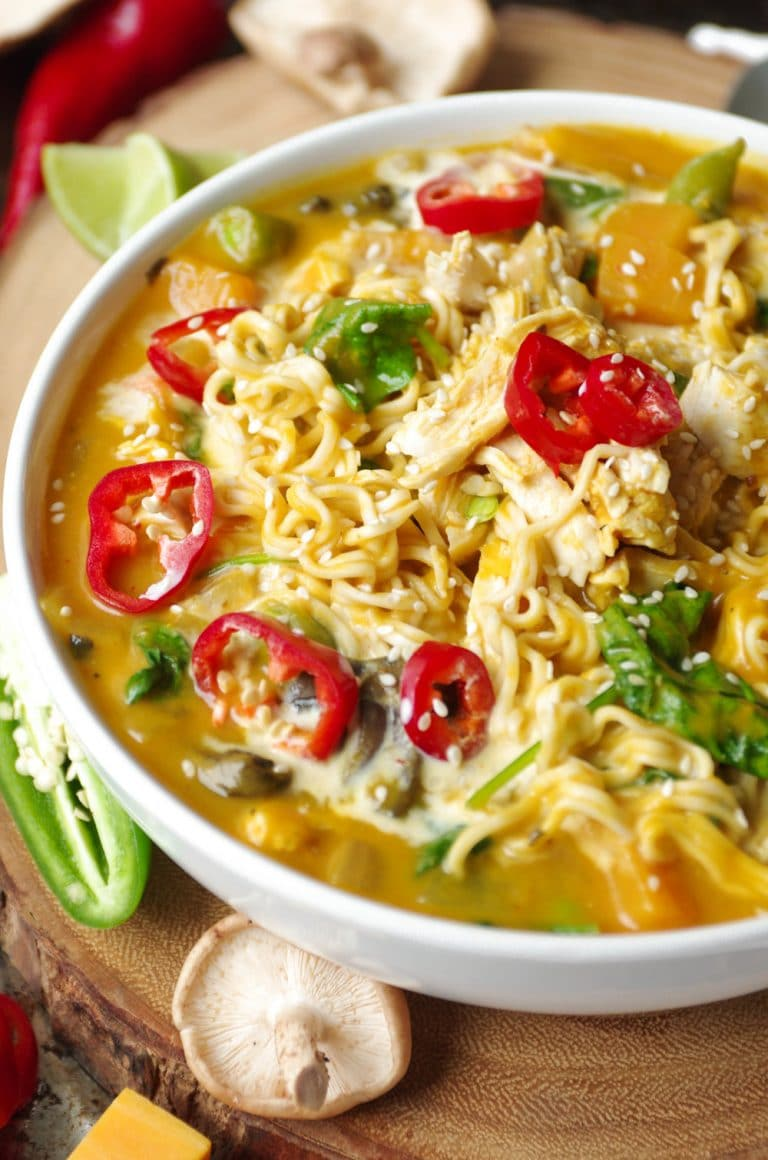 white bowl filled with Spicy Thai Pumpkin and Butternut Squash Ramen with Chicken