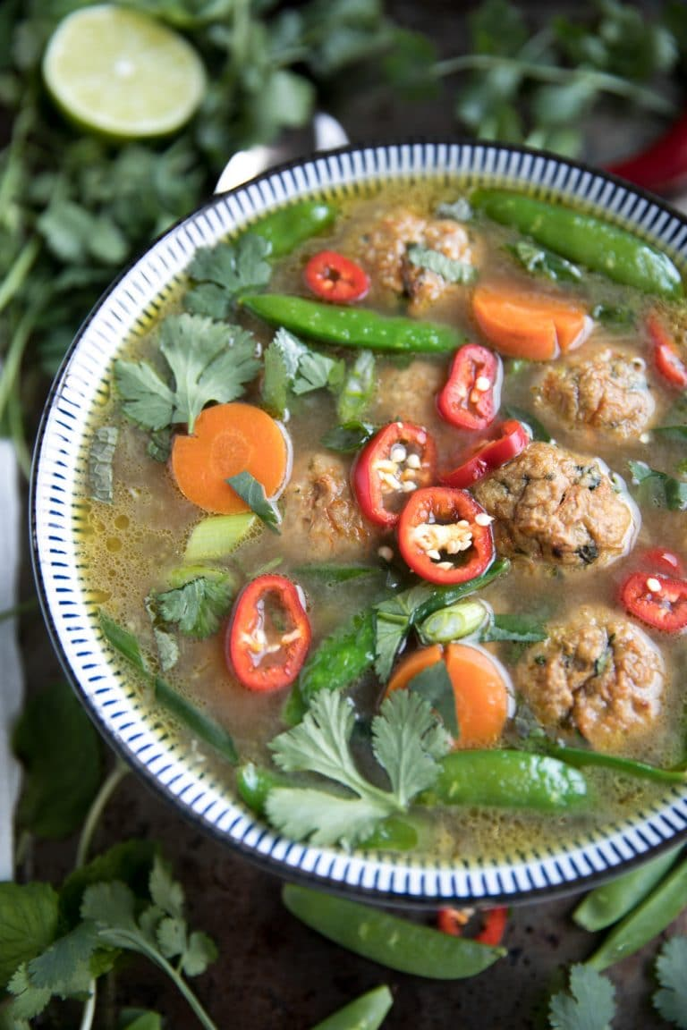 close up of Healthy Thai Veggie Soup with Spicy Thai Meatballs in blue bowl