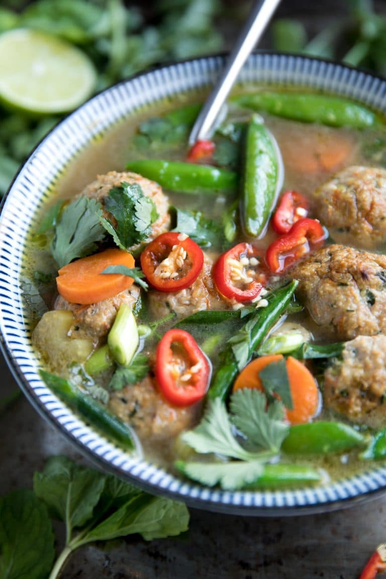 Healthy Thai Veggie Soup with Spicy Thai Meatballs in blue bowl