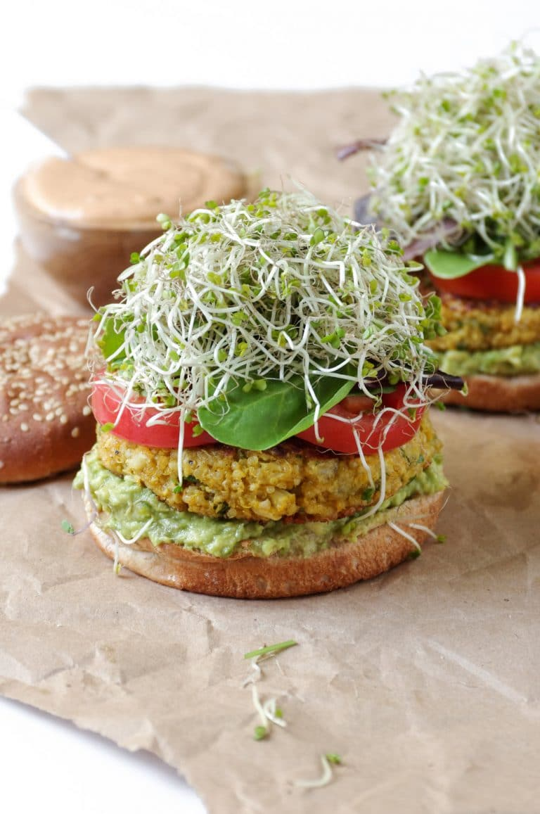 open face Easy Cauliflower Veggie Burgers with Avocado and Chipotle Mayo on brown paper