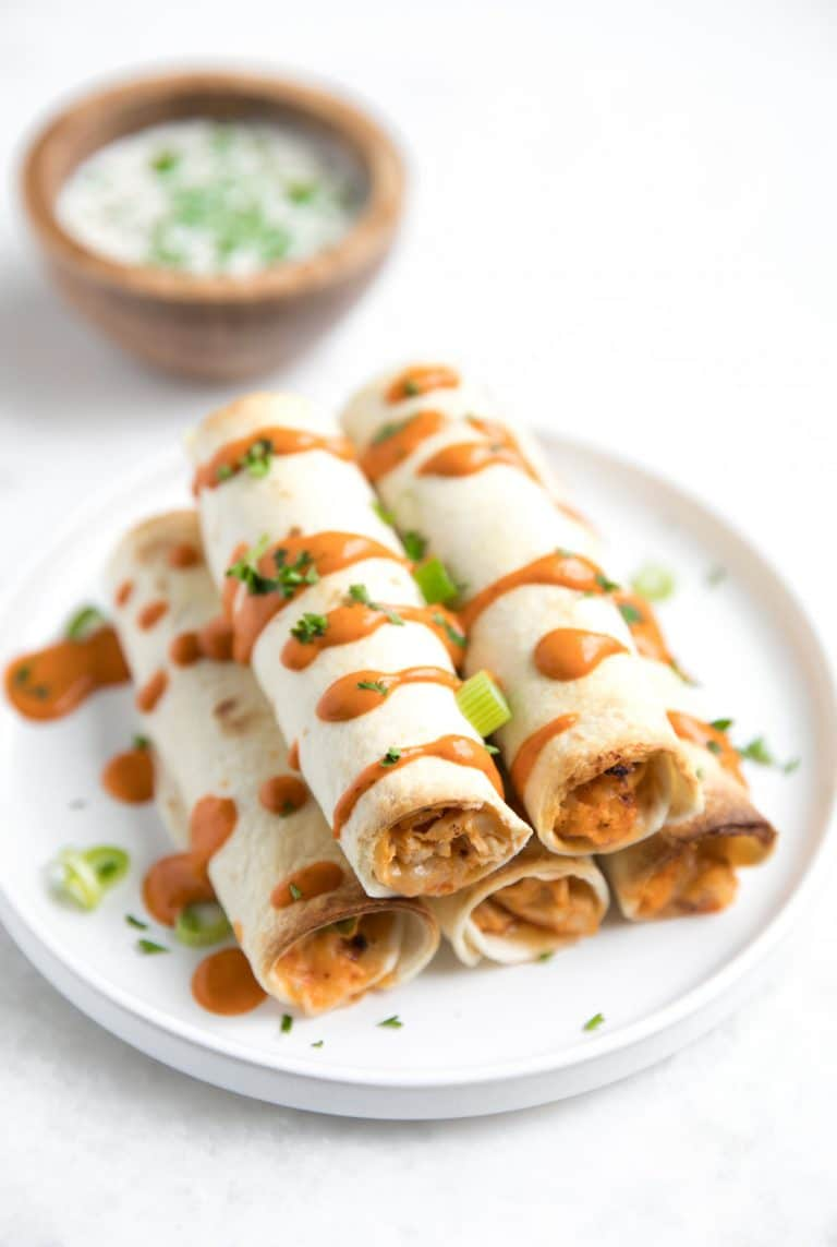 close up of 5 stacked Buffalo Chicken and Cauliflower Taquitos