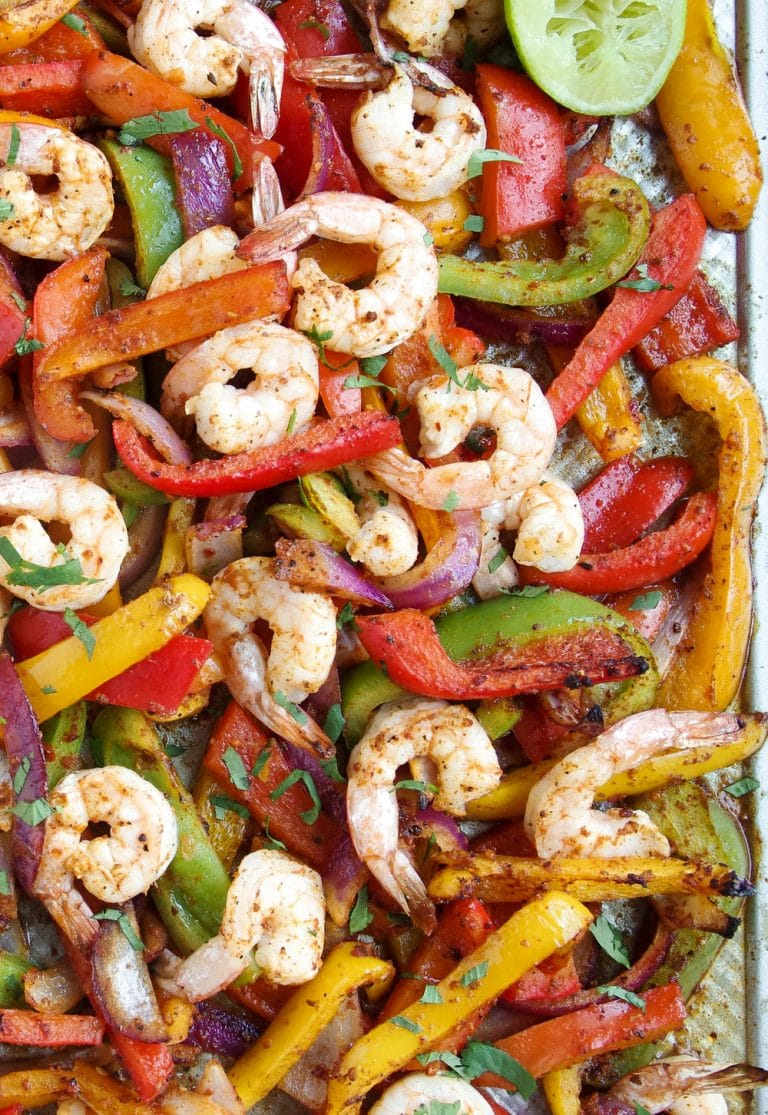 cooked Sheet Pan covered in Shrimp onions and bell peppers