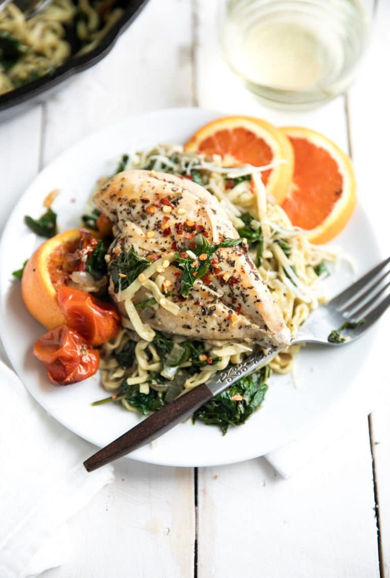 white plate with Chicken and Spinach Linguine with Roasted Cherry Tomatoes