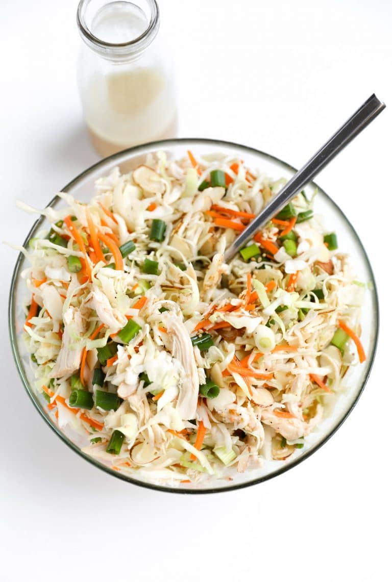 glass bowl full of Chicken and Cabbage Salad with Light Sesame Vinaigrette in jar