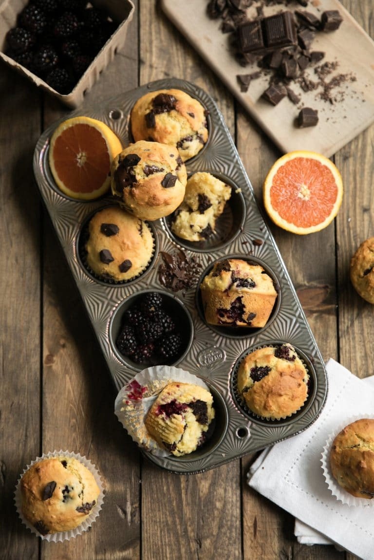 overhead image of Blackberry and Orange Muffins with Dark Chocolate in muffin pan