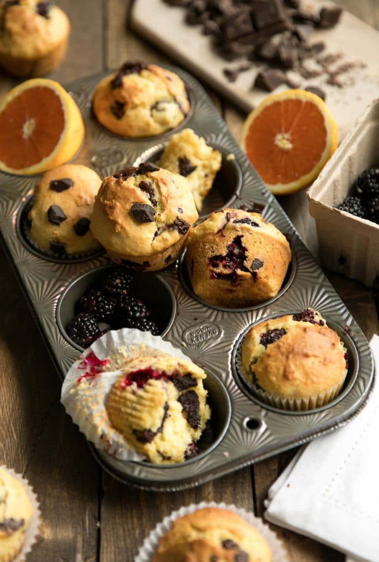 Blackberry and Orange Muffins with Dark Chocolate Chunks in pan