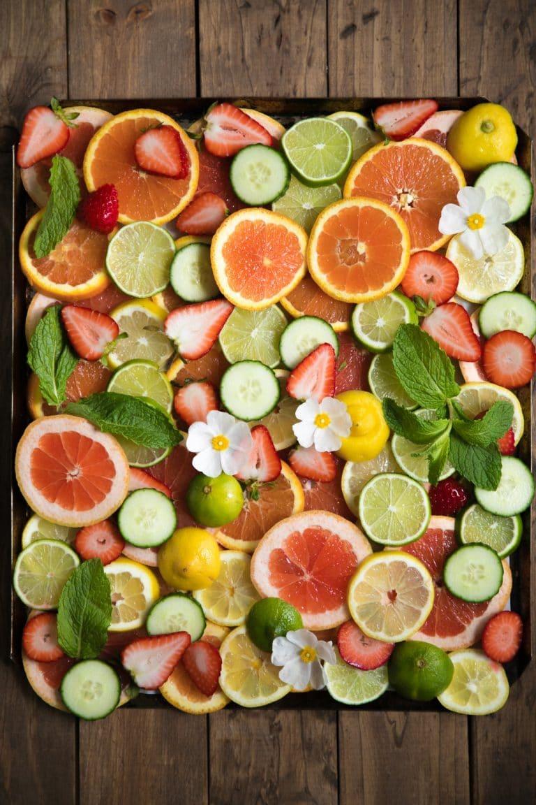 sliced oranges strawberries oranges blood oranges lemons limes mint cucumbers mint