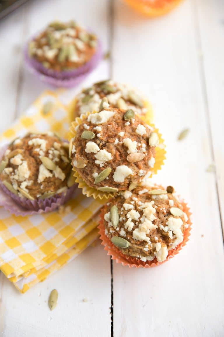 pile of Carrot Cake Muffins with Streusel Topping