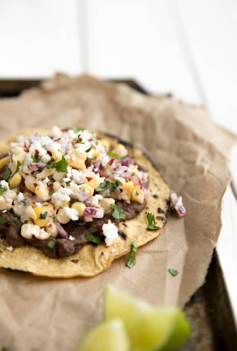 A close up of Mexican street corn tostadas