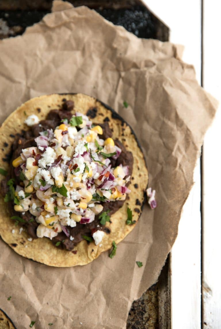 close up of single Mexican Street Corn Tostadas with Chipotle Black Beans
