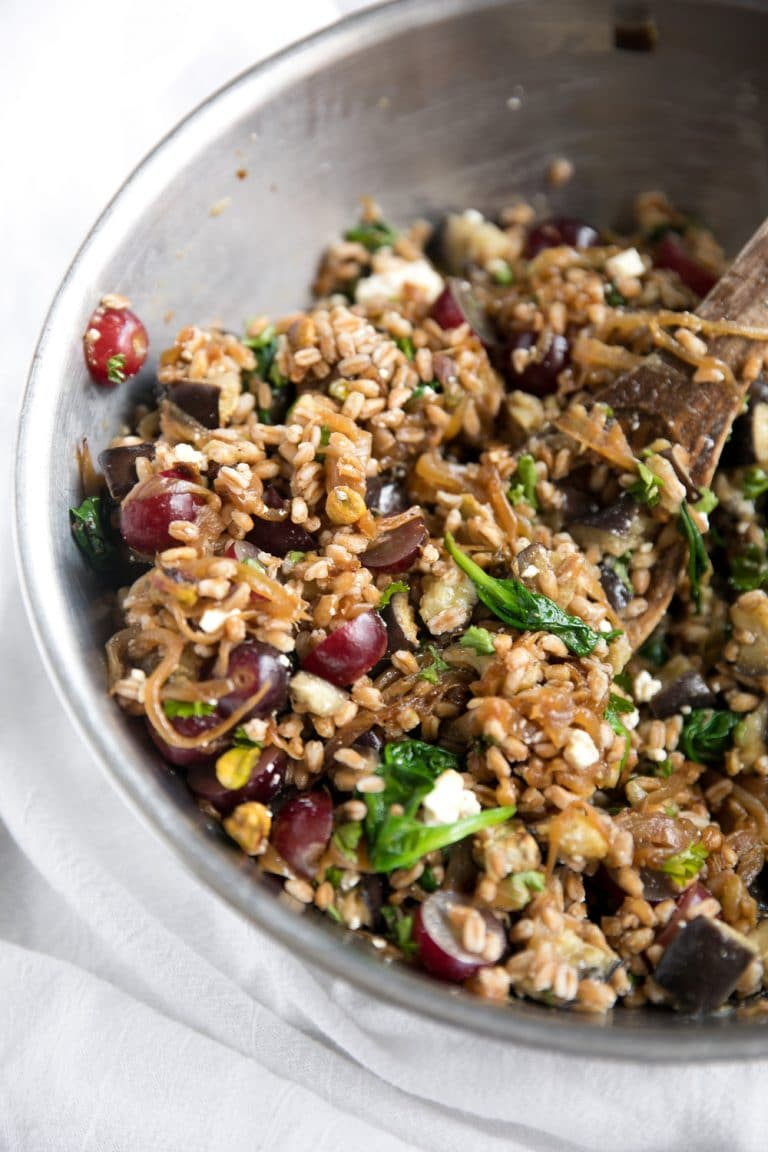 close up of Roasted Eggplant and Caramelized Onion Farro Salad in mixing bowl