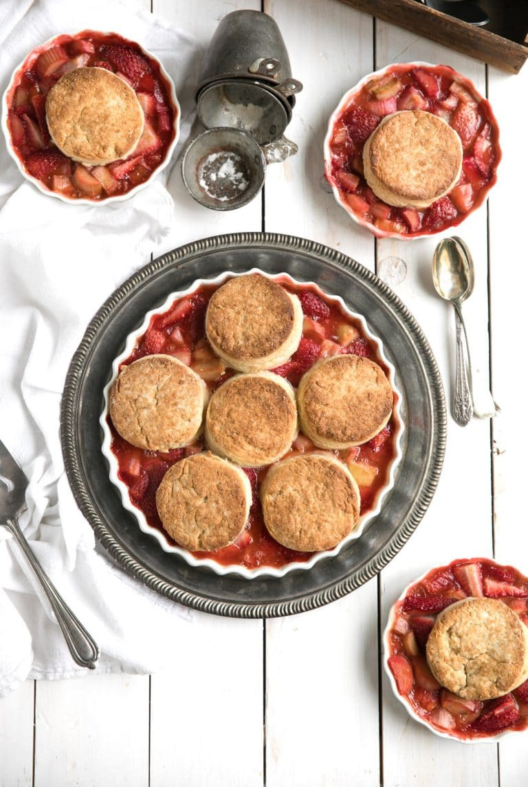 The perfect balance of sweet strawberries and sour rhubarb topped with easy homemade honey butter biscuits in this springtime favorite Strawberry Rhubarb Cobbler.