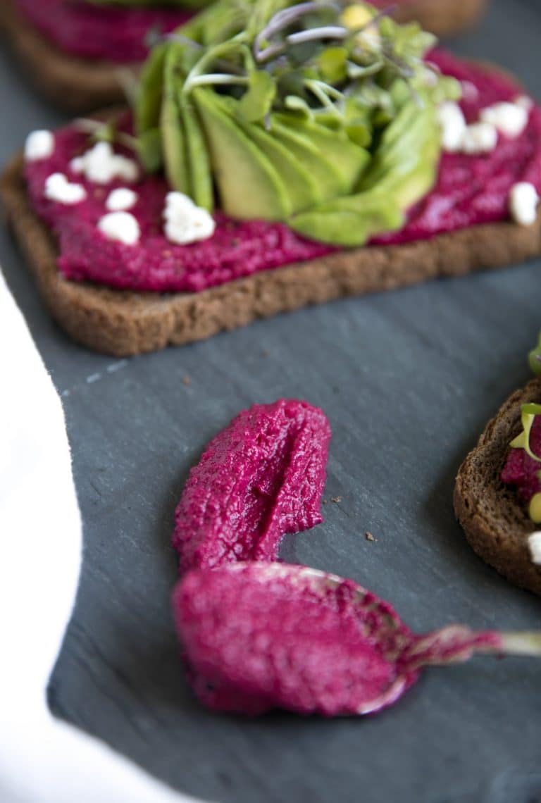 close up of single Avocado Toast with Beet Hummus and spoonful of beet hummus