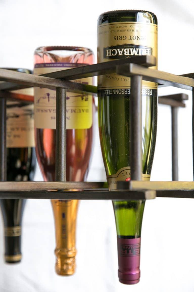 3 wine bottles upside down