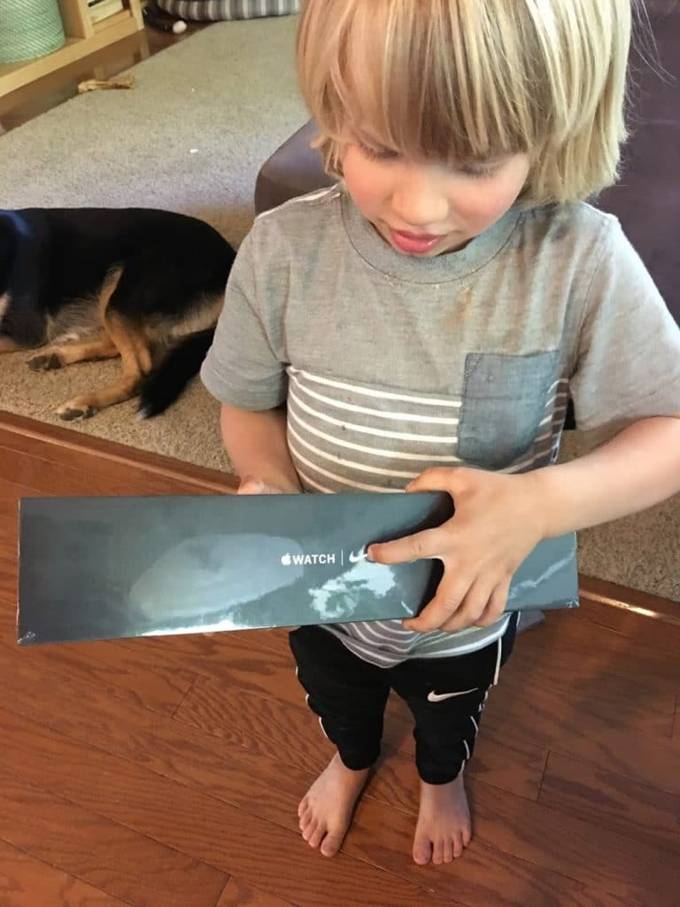 child holding unwrapped nike apple watch