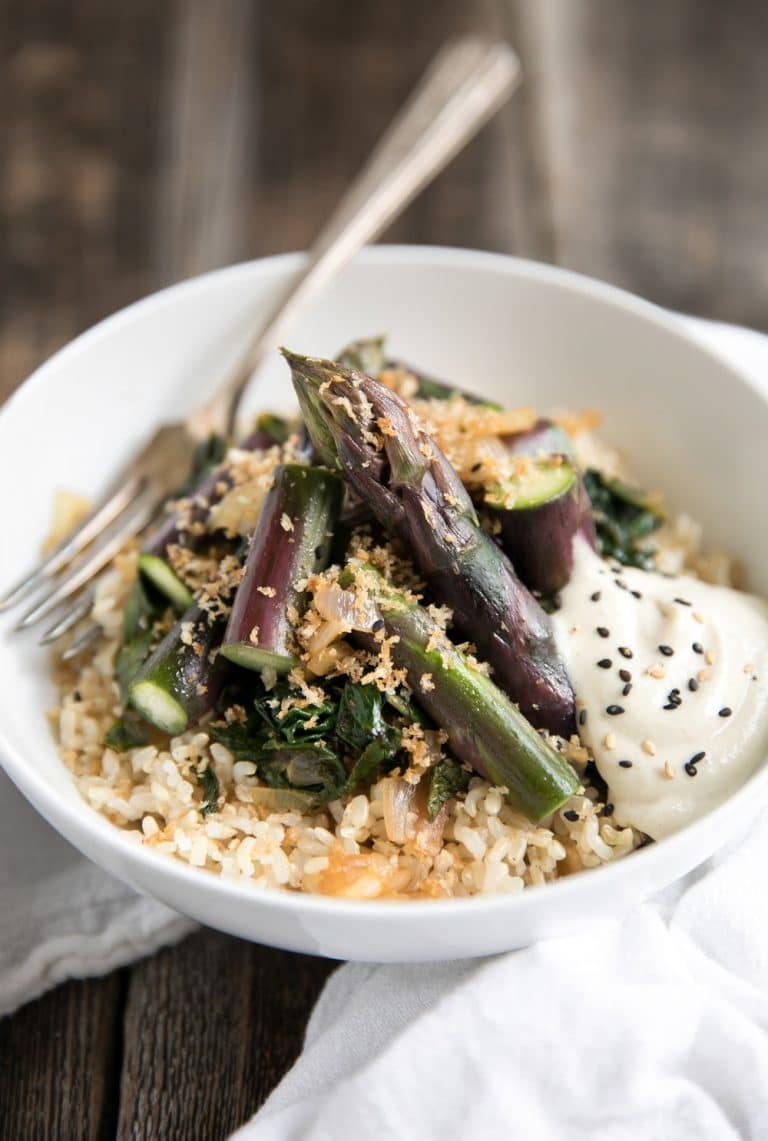 close up of Purple Asparagus in white bowl