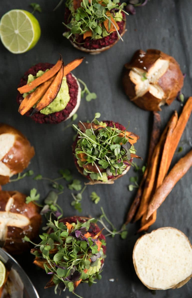 overhead photo of open face Vegetarian Beet Burgers with Avocado and Sweet Potato Fries