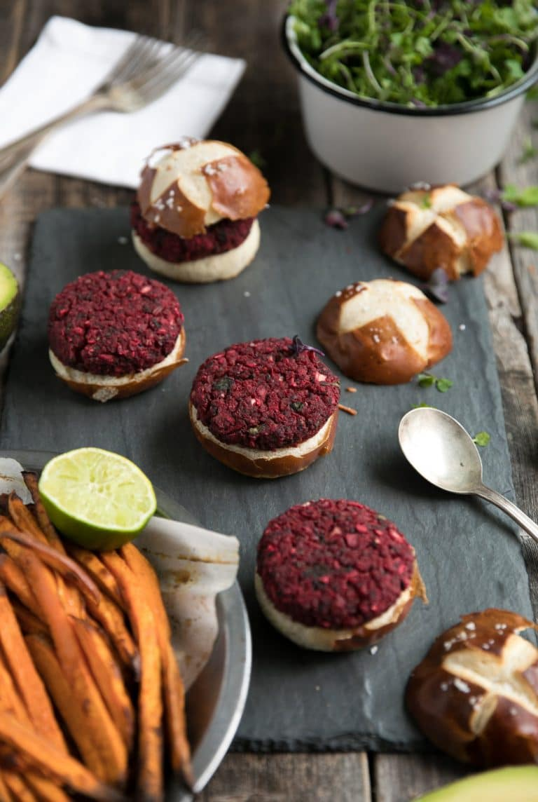 Vegetarian Beet Burgers on buns and Sweet Potato Fries in side dish