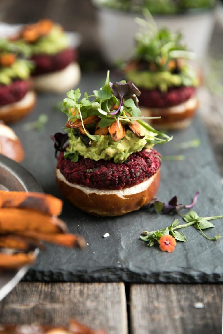 close up of Vegetarian Beet Burgers with Avocado and Sweet Potato Fries