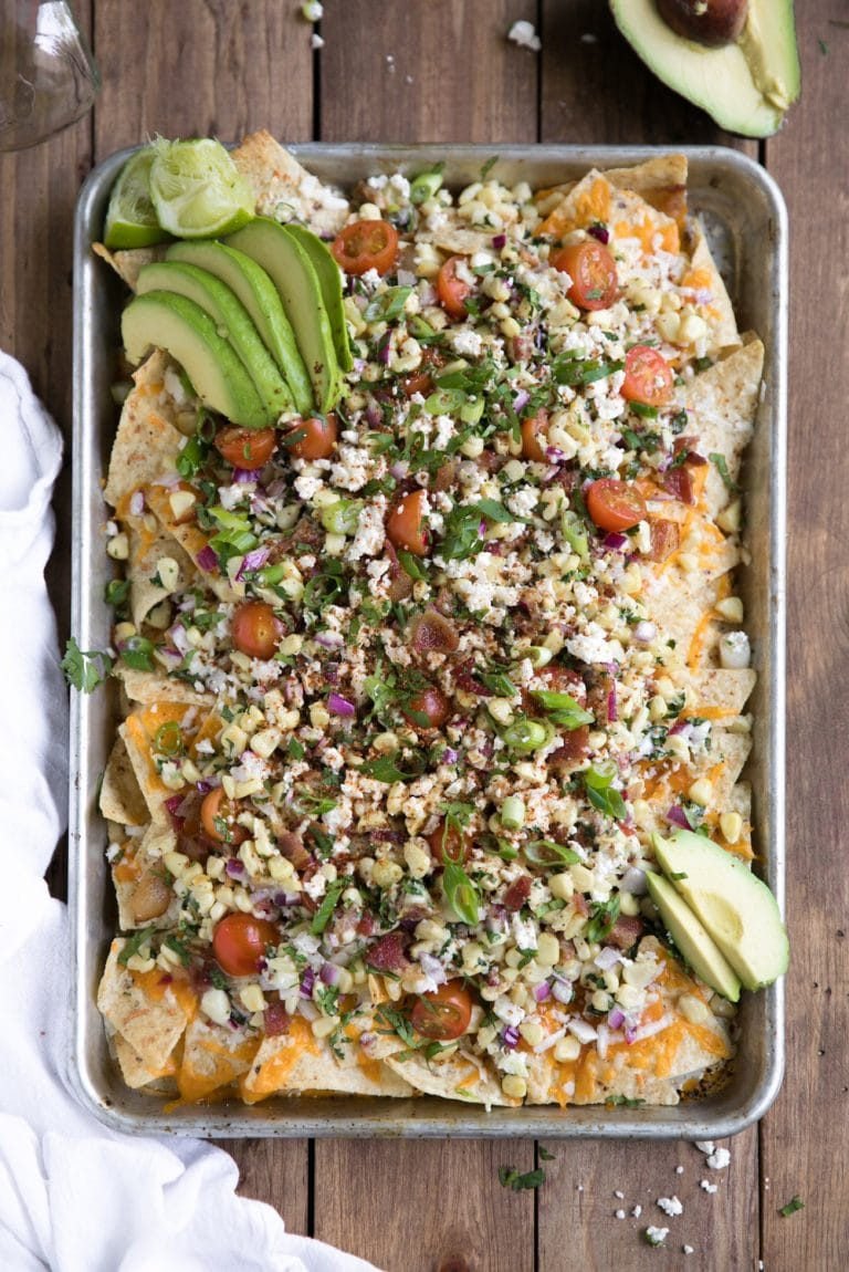 overhead image of Mexican Street Corn Nachos with Bacon with acovado