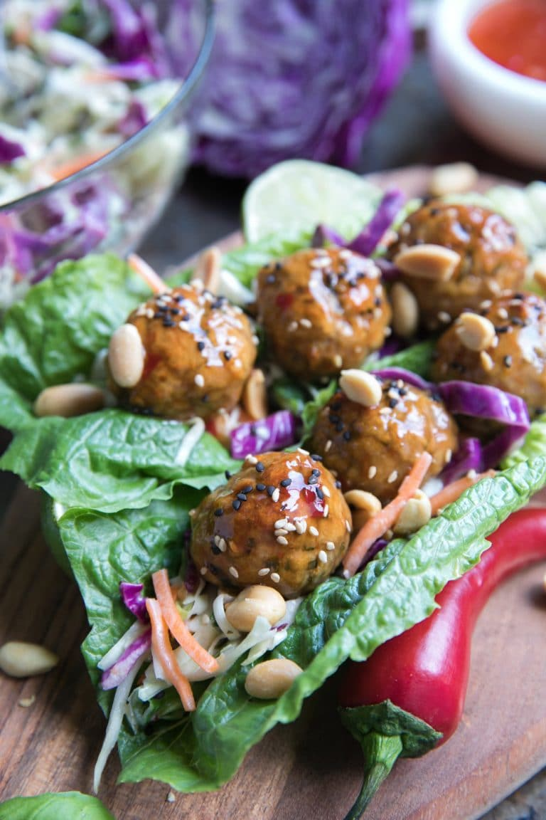 Two Thai Meatball Lettuce Wraps with Cabbage Slaw in a glass dish
