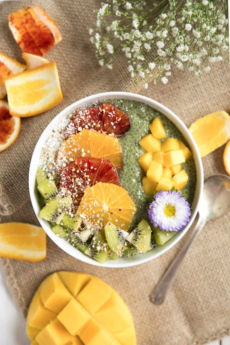 A bowl of fruit in matcha chia pudding